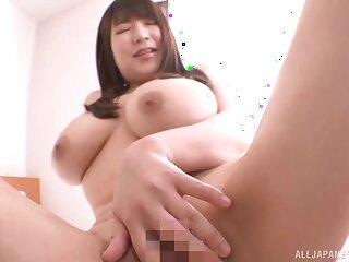 Curvy Japanese girl Yuzuki Marina spreads her legs to tease